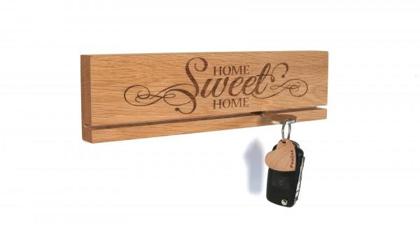 Schlüsselbrett mit verschiedenen Gravuren aus Holz